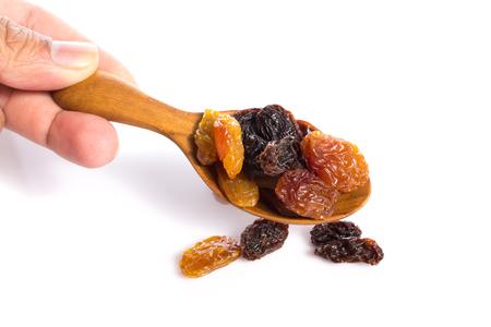 jumbo: jumbo raisins in wooden spoon on white Stock Photo
