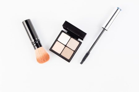 curler: cheek brush and eye shadow with  eyelash curler on white Stock Photo