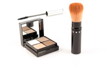 set up: close up eye shadow with cheek brush on white Stock Photo