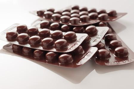 antibiotic capsule: close up of drug or antibiotic capsule