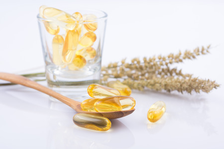 evening primrose: close up Evening primrose oil capsule,supplementary food Stock Photo