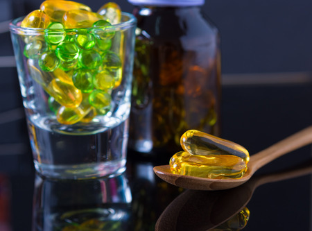 nutritional therapy: close up Evening primrose oil capsule,supplementary food Stock Photo