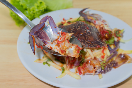 Salted crab in the dish on wooden plate