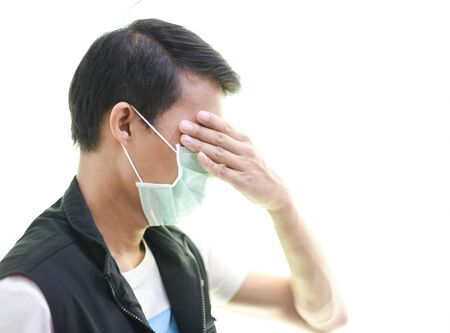 Depositphotos Stock Photos Coronavirus or covid 19, a man wearing a mask to protect against germs showing undesirable germs on a white backgroun