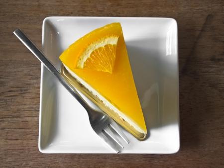 orange cake: Orange cake on wood background