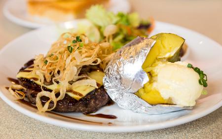 Hamburger beef steak with baked potato photo