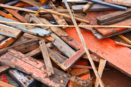 spall: pile of old , dirty and broken wood