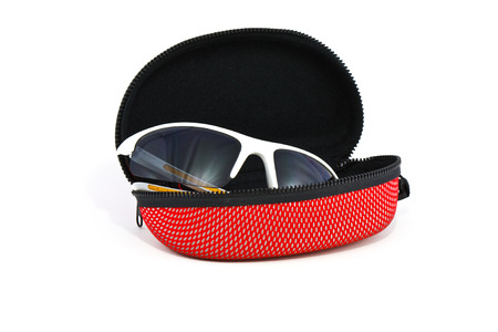 Sport sunglasses and case on a white background photo