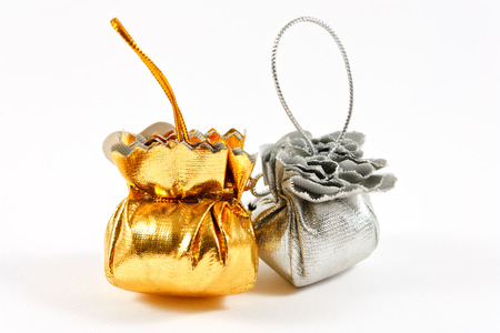 Gold bag and Silver bag on white background photo