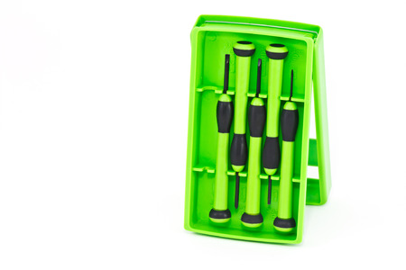 Green screwdriver set  on white background photo