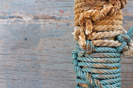 lashing: Two color braided rope around steel