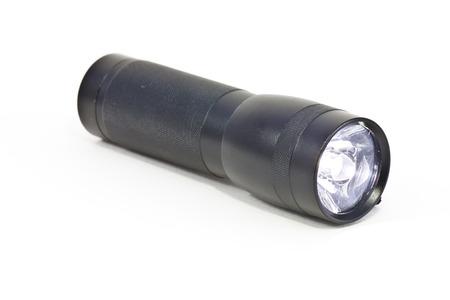 small led flashlight on white background photo