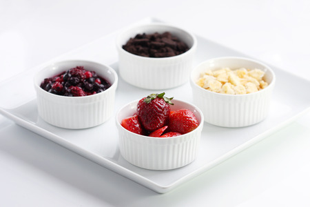 graham: A dish of graham cracker, mixed berries, Oreo, Strawberry
