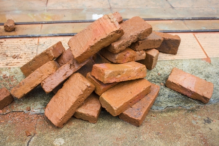 group of red bricks on construction site Stock Photo