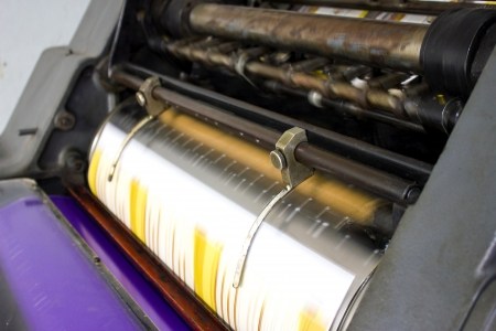 offset up: Close up of an offset printing machine during production