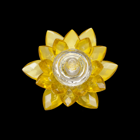 Glass lotus flower isolated on black background