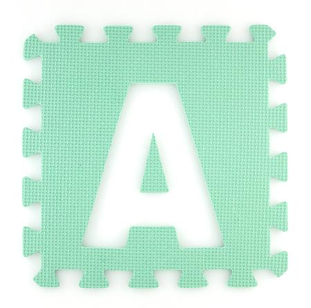 Alphabet puzzle pieces isolated white background