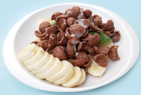 Cereals chocolate with avocado and banana poured sweetened condensed milk