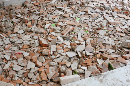 The piles of brick rubble, stone and concrete rubble. Remains of the destroyed industrial building.