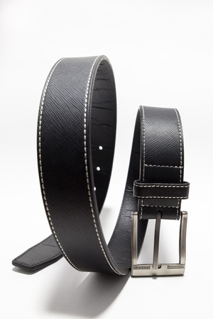 Black leather belt on a white background.