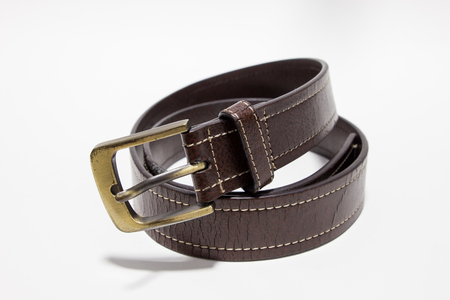 Brown leather belt on a white background.