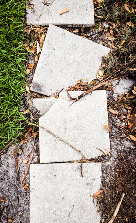 Broken pathway pavement slabs 写真素材