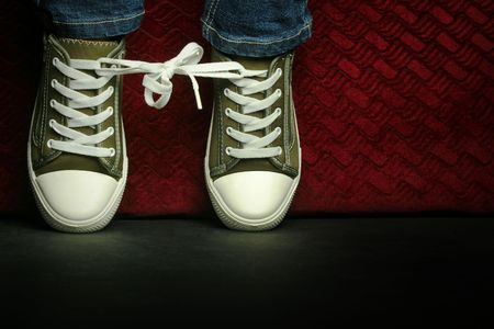 Tied up shoes in the spotlight Stock Photo - 9029849