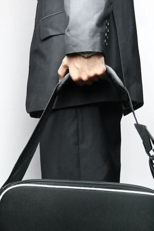 bags in hands: Business man with a laptop bag isolated on white background