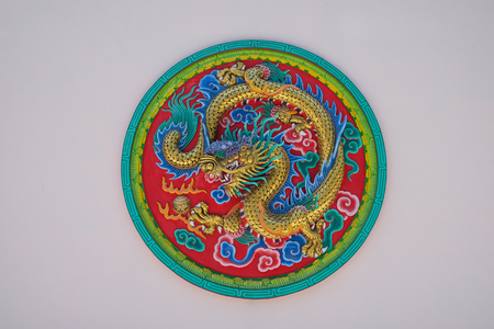 taoist: asia architecture, dragon in circle white wall background