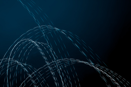 Abstract design of light painting. Blue lights against dark background. Dynamic picture