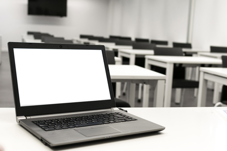 Laptop, online business, teacher work in the classroom.Laptop put on a table or desk located in empty room.