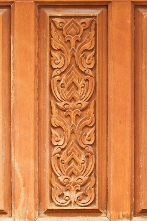 lacquerware: thai delicate pattern carved on temple wooden door  Stock Photo
