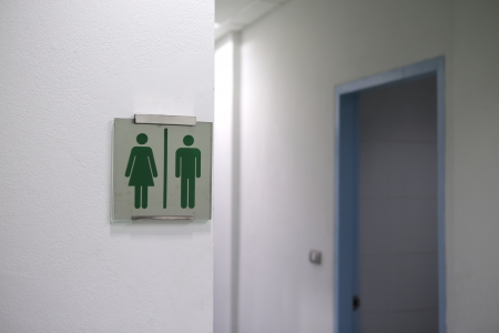 water closet: green water closet sign on white wall