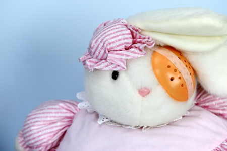 eye pad: cute little bunny doll with orange eye pad on left eye  Stock Photo
