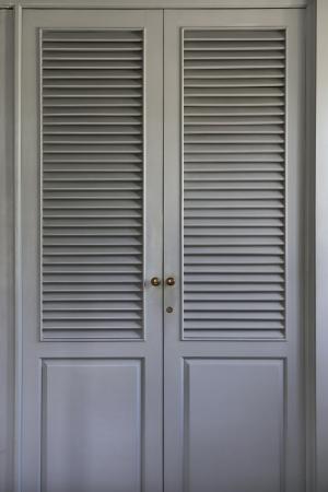closet door: plain gray closet door panels with golden knobs