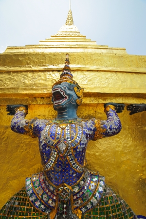 stucco statue of half monkey half angel carrying golden chedi, thailand Stock Photo - 18691381