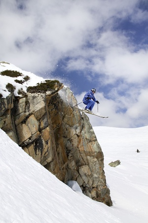 flying skier on mountains photo