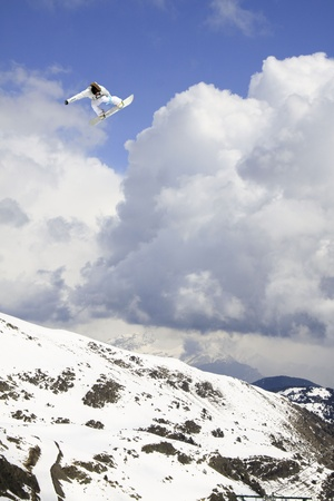 Snowboarder jumping high in the air Stock Photo - 13193252