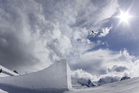 flying snowboarder on mountains Stock Photo - 13372113