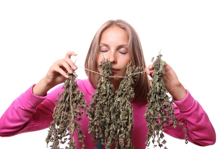 herbalist: young woman with medicinal plants, isolated