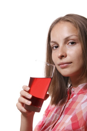 Young woman with glass of red drink photo