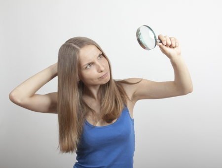 Woman with Magnifying Glass Stock Photo - 14370871