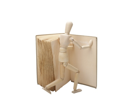 wood figurine: Wooden man and book Stock Photo