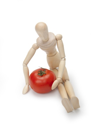 Mannequin and tomato photo
