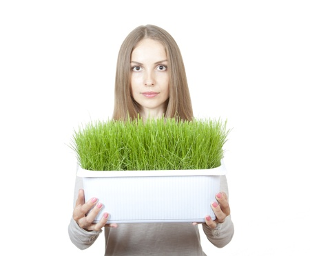 Young Woman Holding Pot of Green Grass photo
