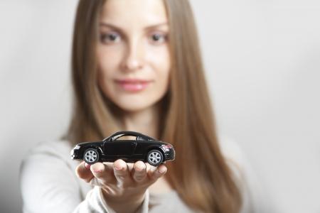 woman holding little car