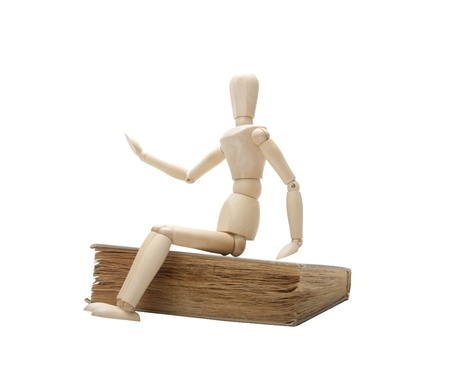 Wooden man and book photo