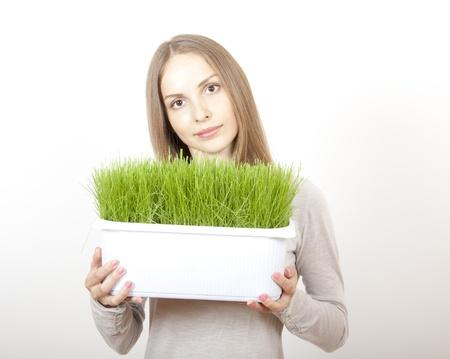 Woman Holding Pot of Green Grass photo