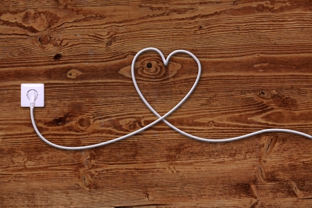 outlet: electrical outlet and wire in the shape of a heart