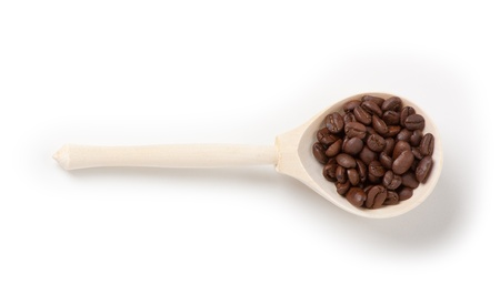 wooden spoon with coffee beans, isolated photo